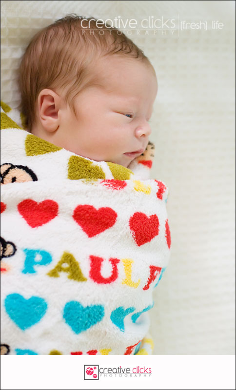 Newborn baby boy wrapped in blanket