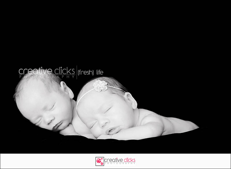 Newborn twins boy and girl sleeping
